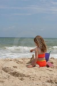 girl-building-sand-castle-1-1012060