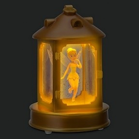 tinker-bell-description-inspired-by-the-moment-in-peter-pan-when-the-pretty-pixie-is-locked-in-captain-hooks-lamp-tinker-bell-seems-to-float-in-a-golden-glow-amidst-a-shower-of-glitter